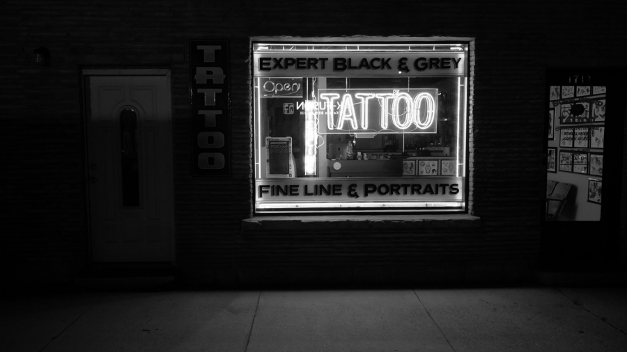 grayscale-photo-of-tattoo-neon-signage-2087995